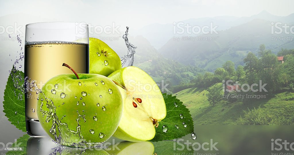 Green Apple and glass of juice. stock photo