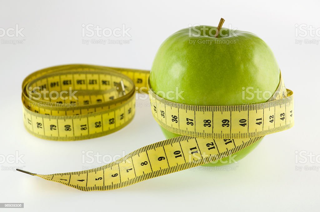 green apple and measurement tape royalty-free stock photo
