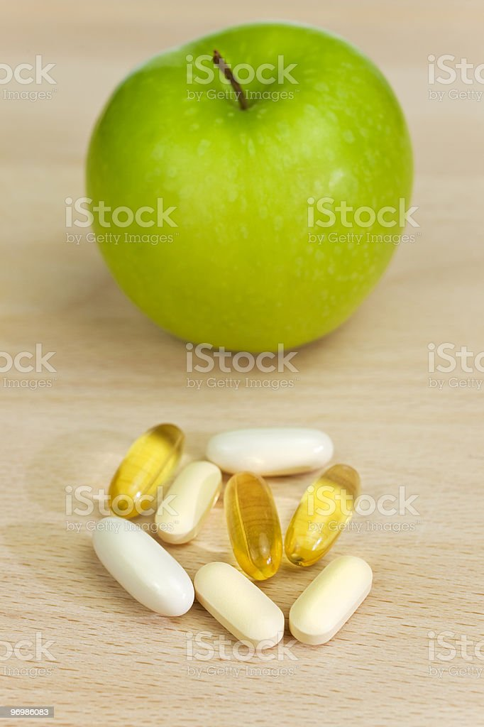Green Apple and Nutrition Supplement Tablets or Medicine royalty-free stock photo