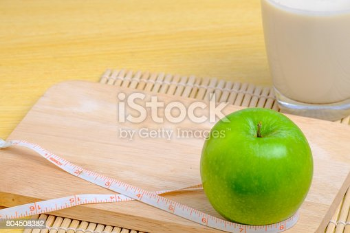 887350996 istock photo green apple and soy milk with tapeline 804508382