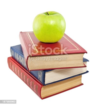 453684295istockphoto green apple and stack of old books 187989960