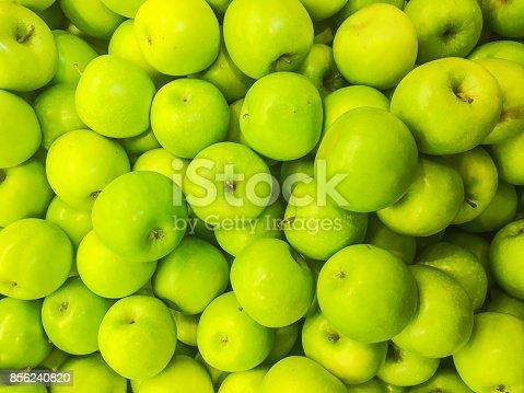 istock Green apple backgrounds 856240820