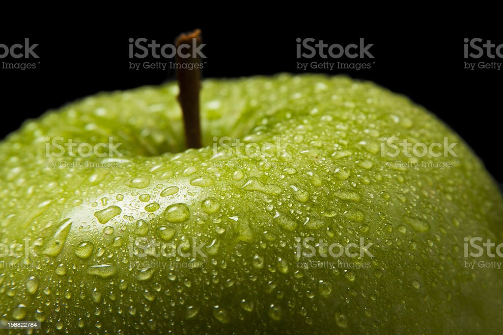 Green Apple Covered in Water Droplets royalty-free stock photo