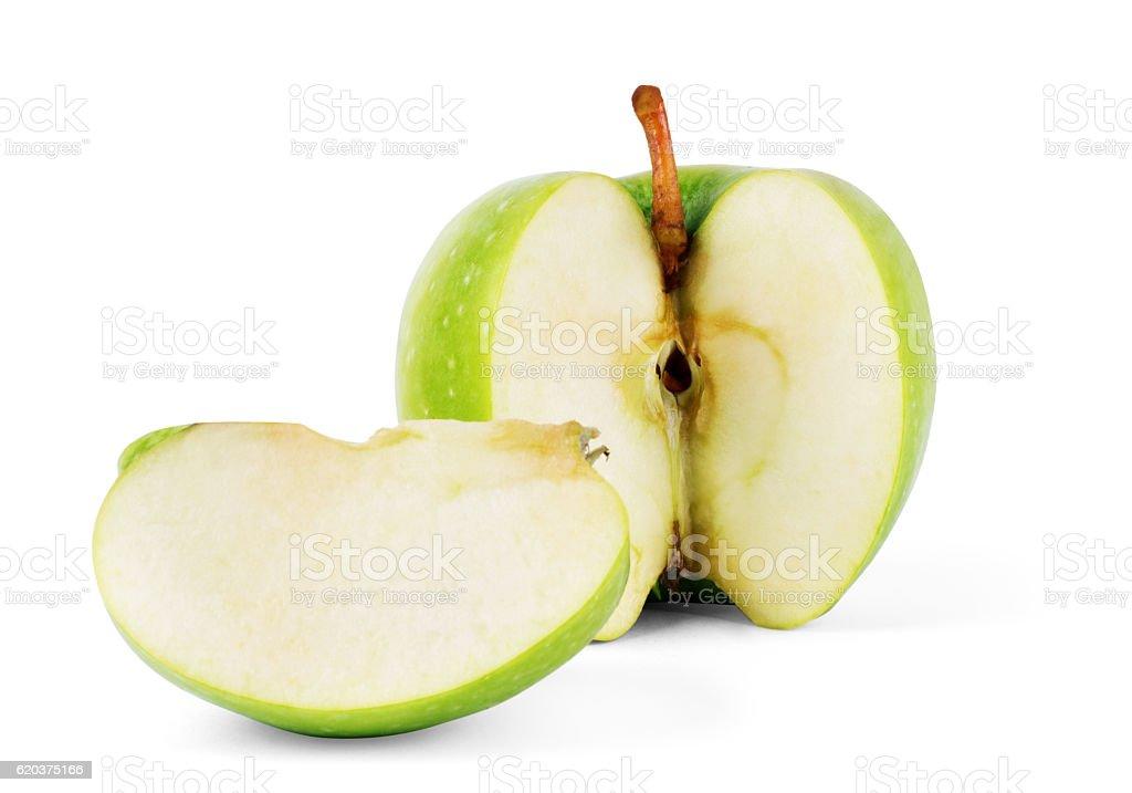 green apple cut in half on white background zbiór zdjęć royalty-free
