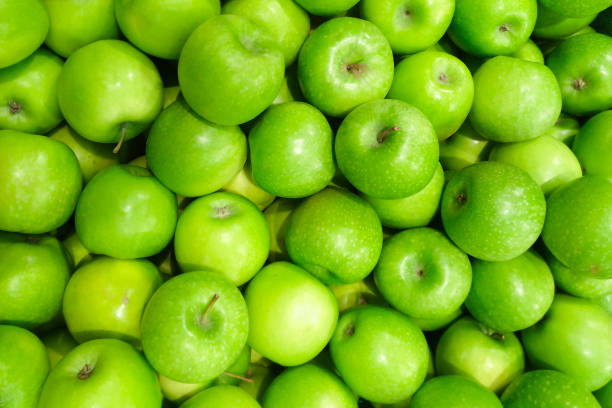 Green apple fruit on sell in supermarket backgrounds.Granny Smith apples contain slightly more vitamin A than Red apple. Green apple fruit on sell in supermarket backgrounds.Granny Smith apples contain slightly more vitamin A than Red apple. granny smith apple stock pictures, royalty-free photos & images