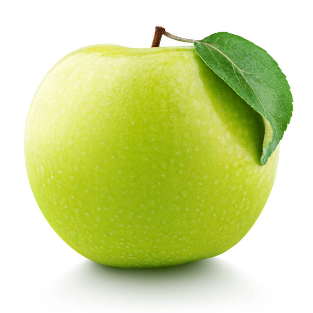 Green apple fruit with green leaf isolated on white Single ripe green apple fruit with green leaf isolated on white background. Granny smith apple with clipping path. Full Depth of Field granny smith apple stock pictures, royalty-free photos & images