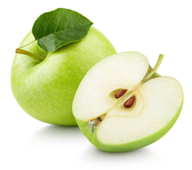 Green apple fruit with half and green leaf isolated on white Ripe green apple fruit with apple half and green leaf isolated on white background. Apples and leaf with clipping path granny smith apple stock pictures, royalty-free photos & images