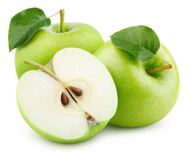 Green apple fruit with half and green leaf isolated on white Group of ripe green apple fruits with half and green leaves isolated on white background. Apples with clipping path. Full Depth of Field granny smith apple stock pictures, royalty-free photos & images