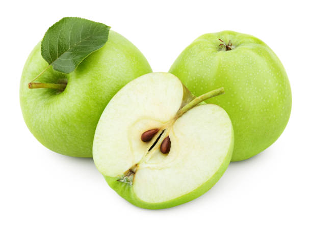 Green apple fruit with half and green leaf isolated on white Group of ripe green apple fruits with apple half and green apple leaf isolated on white background. Apples with clipping path granny smith apple stock pictures, royalty-free photos & images