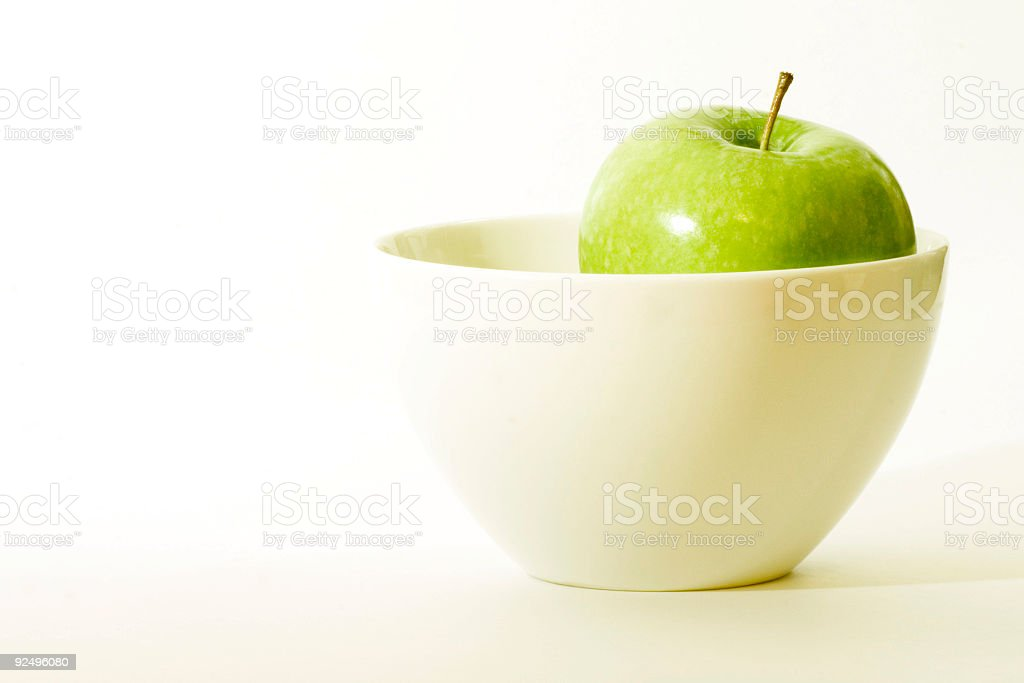 green apple in a bowl royalty-free stock photo