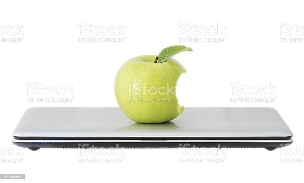 green apple in a closed laptop stock photo