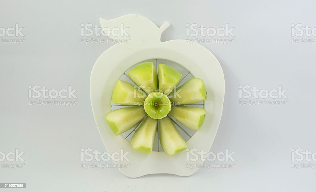 green apple in a fruit-divider stock photo
