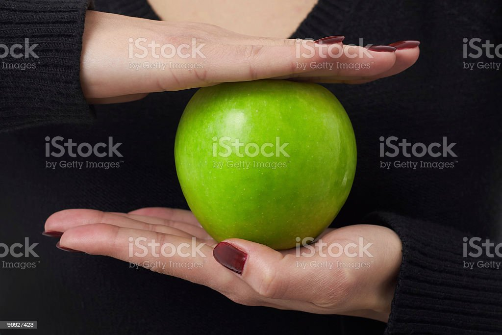 green apple in careful hands royalty-free stock photo