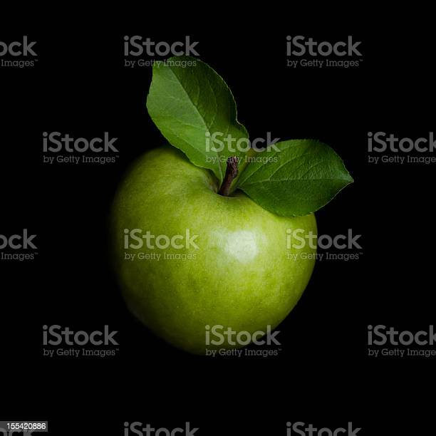 Photo of Green apple isolated on black background