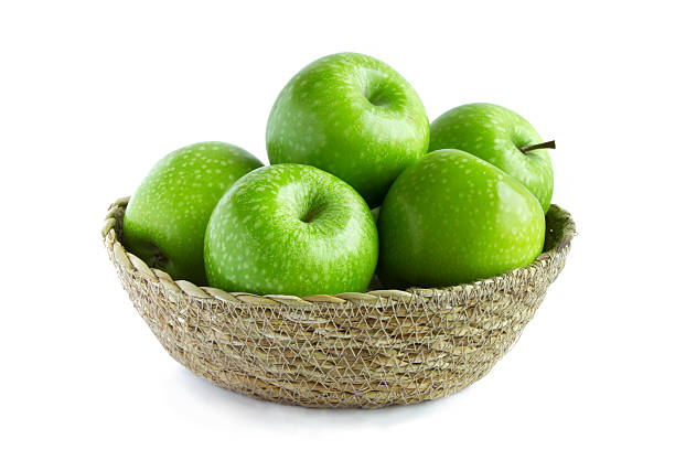Green apple isolated Green apple in woven basket isolated white background granny smith apple stock pictures, royalty-free photos & images