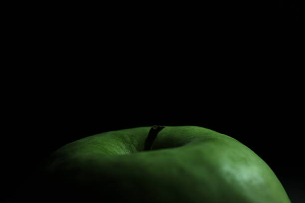 Green apple on a black background stock photo
