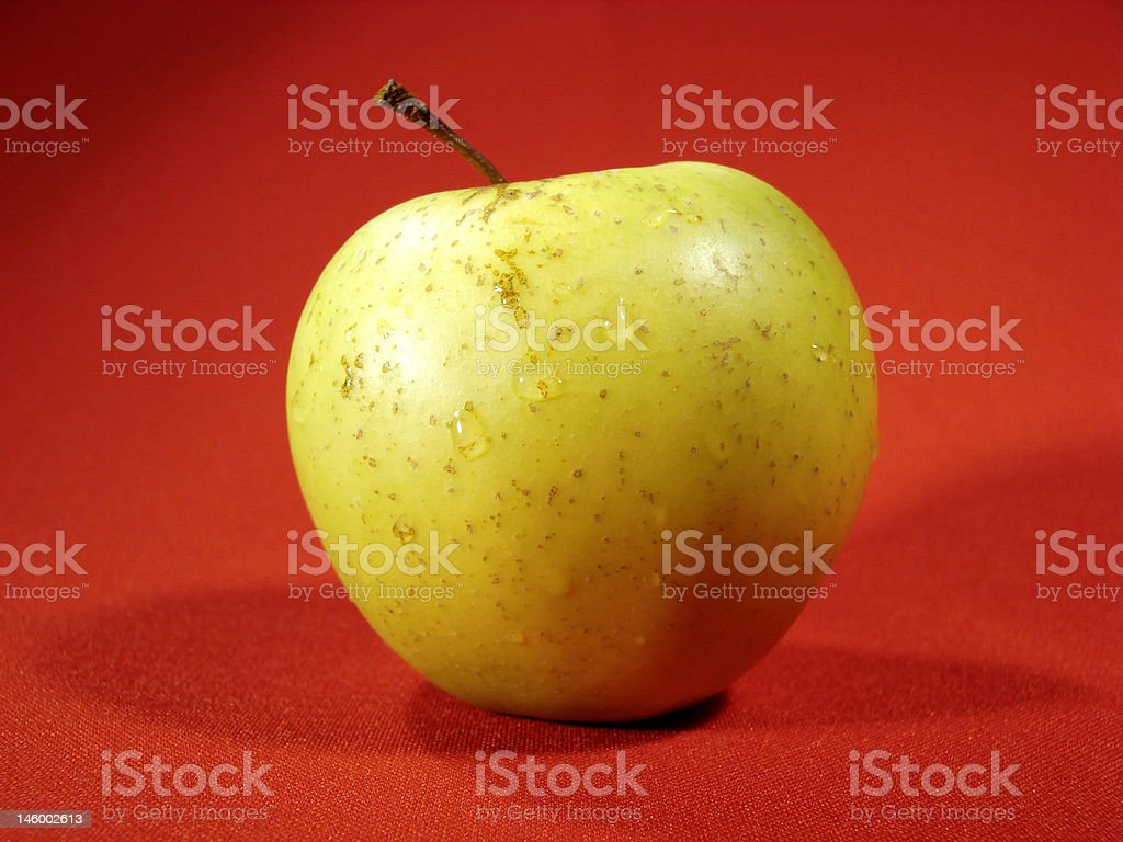 Green apple on red stock photo