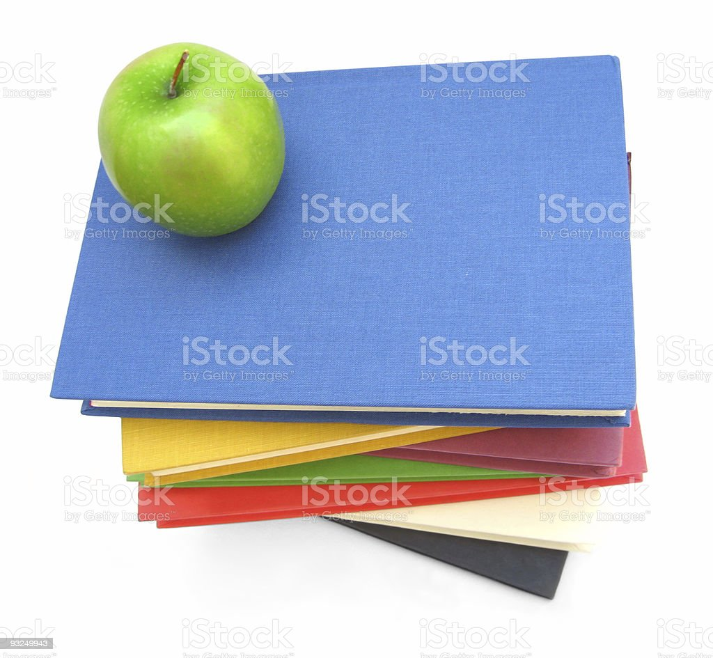 Green apple on stack of books royalty-free stock photo
