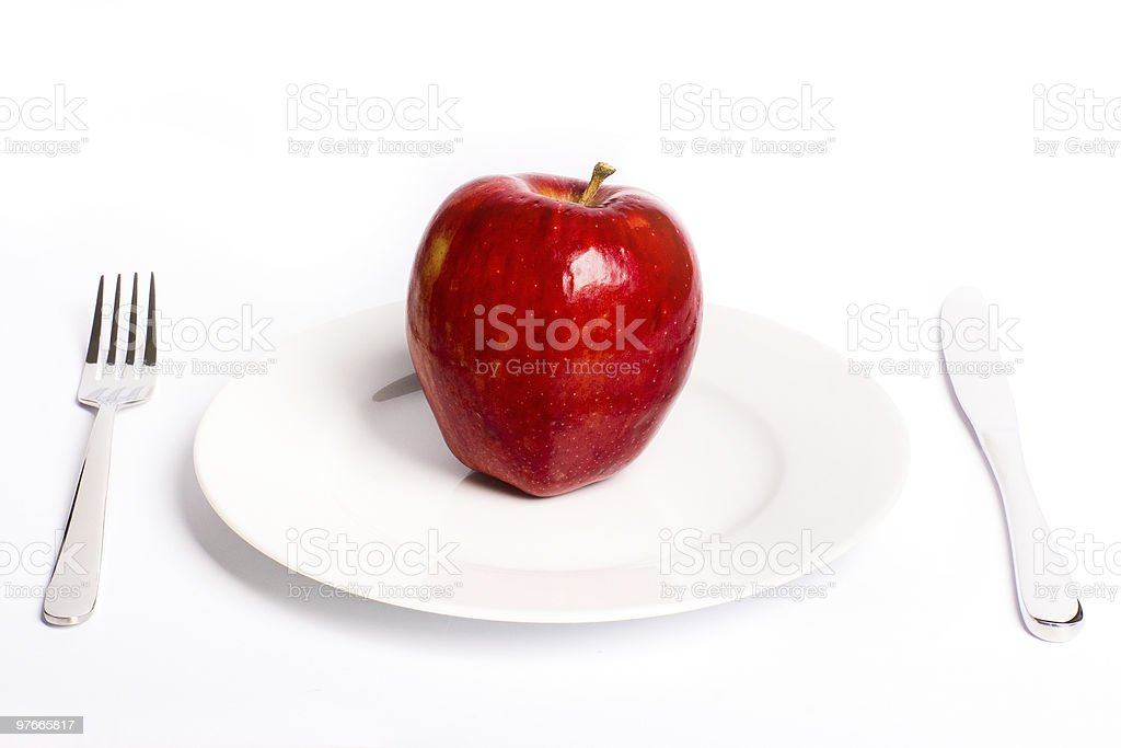 Green apple on white plate royalty-free stock photo