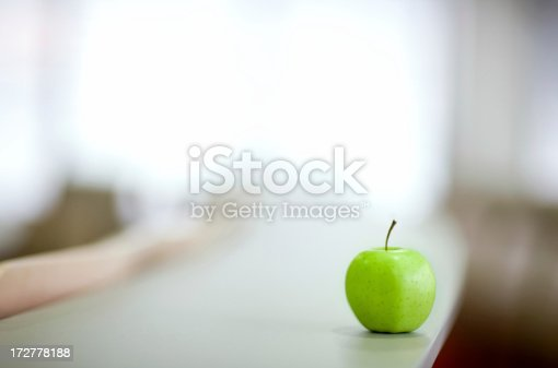 green apple in a modern auditorium or classroom