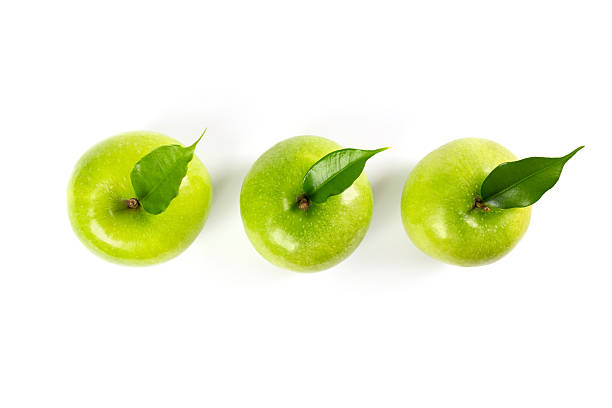 green apple (isolated) green apple (isolated) granny smith apple stock pictures, royalty-free photos & images