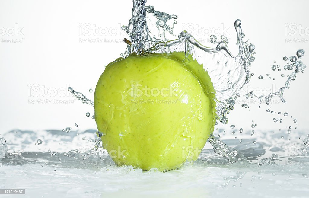 Green Apple. Water Splash. stock photo