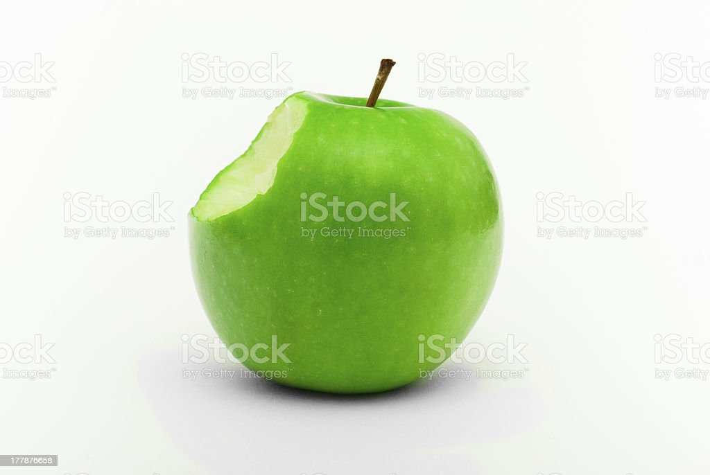 Green Apple With A Bite Mark stock photo