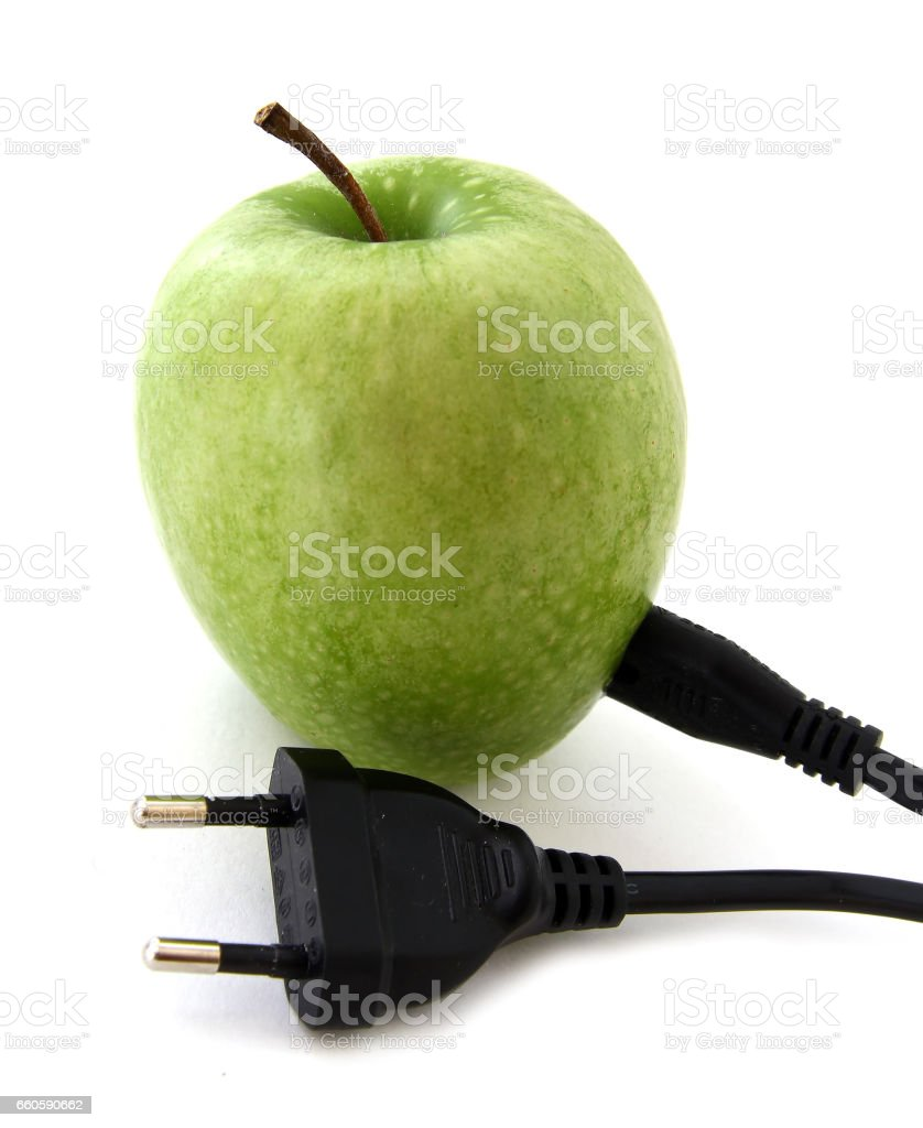 Green apple with a plug stock photo