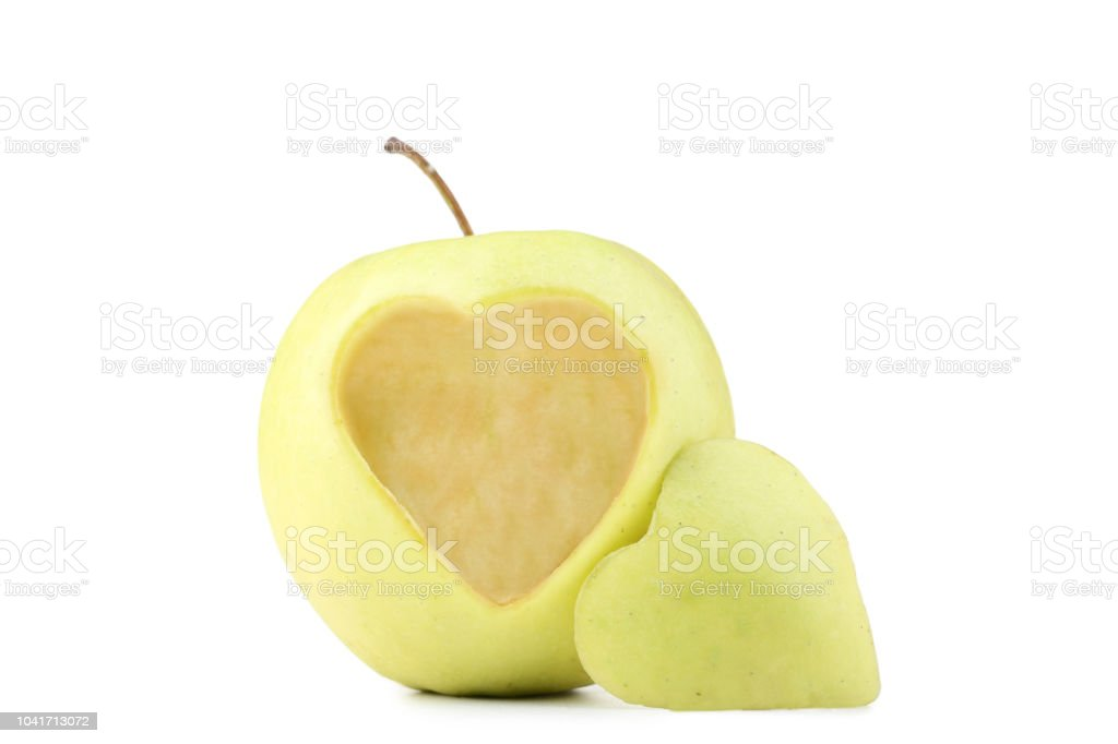 Green Apple With Cutout Heart Shape On White Background