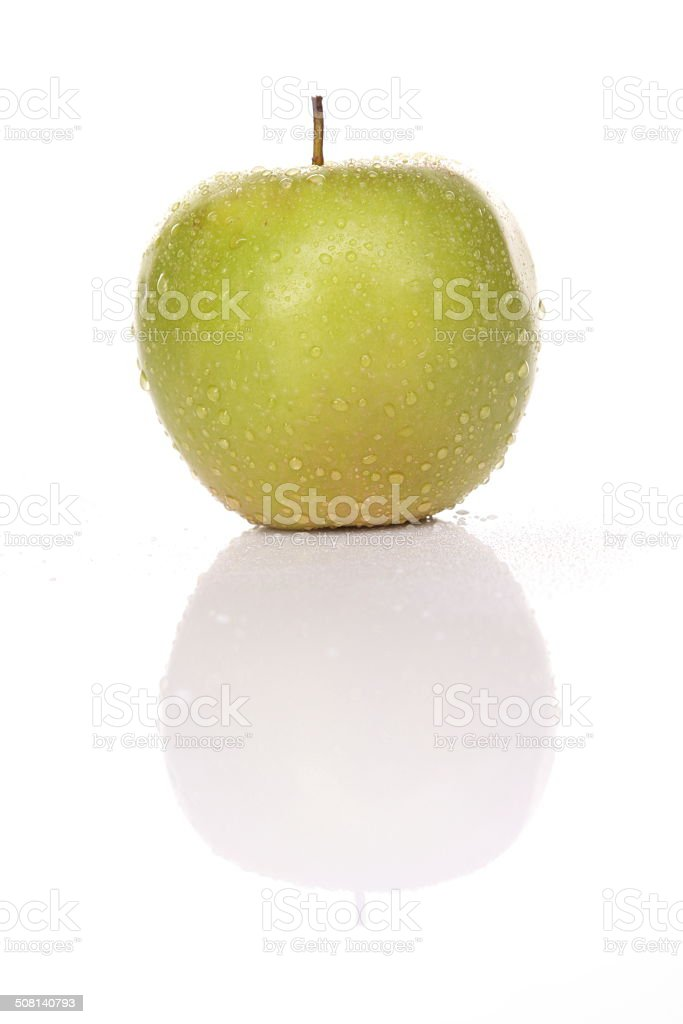 Green apple with drops of water and shadow stock photo