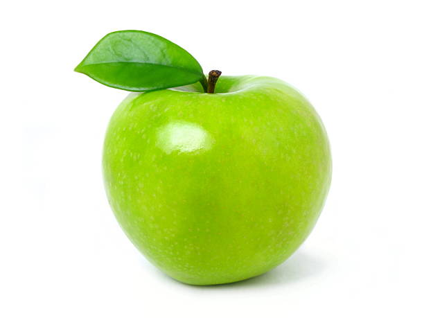 Green apple with leaf on a white backdrop stock photo