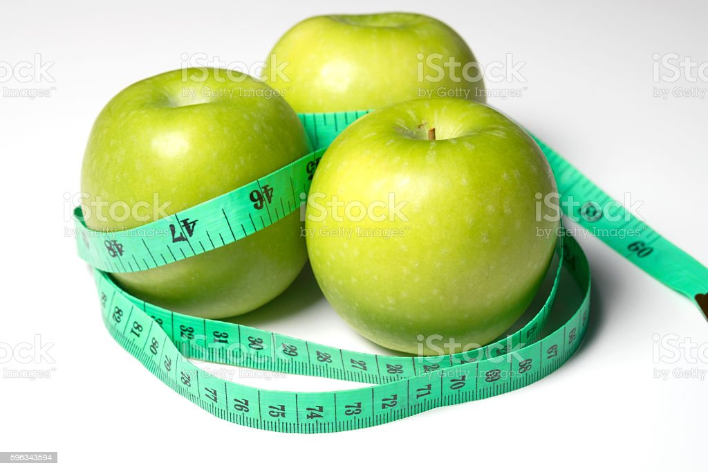 Green apple with Measure the length on white background. royalty-free stock photo