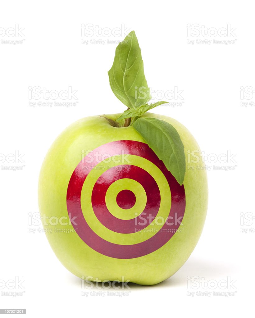 Green apple with target drawn on it royalty-free stock photo