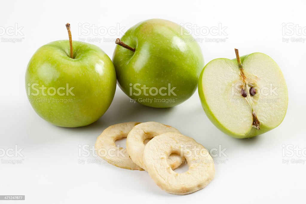 Green apples and dried apple composition stock photo