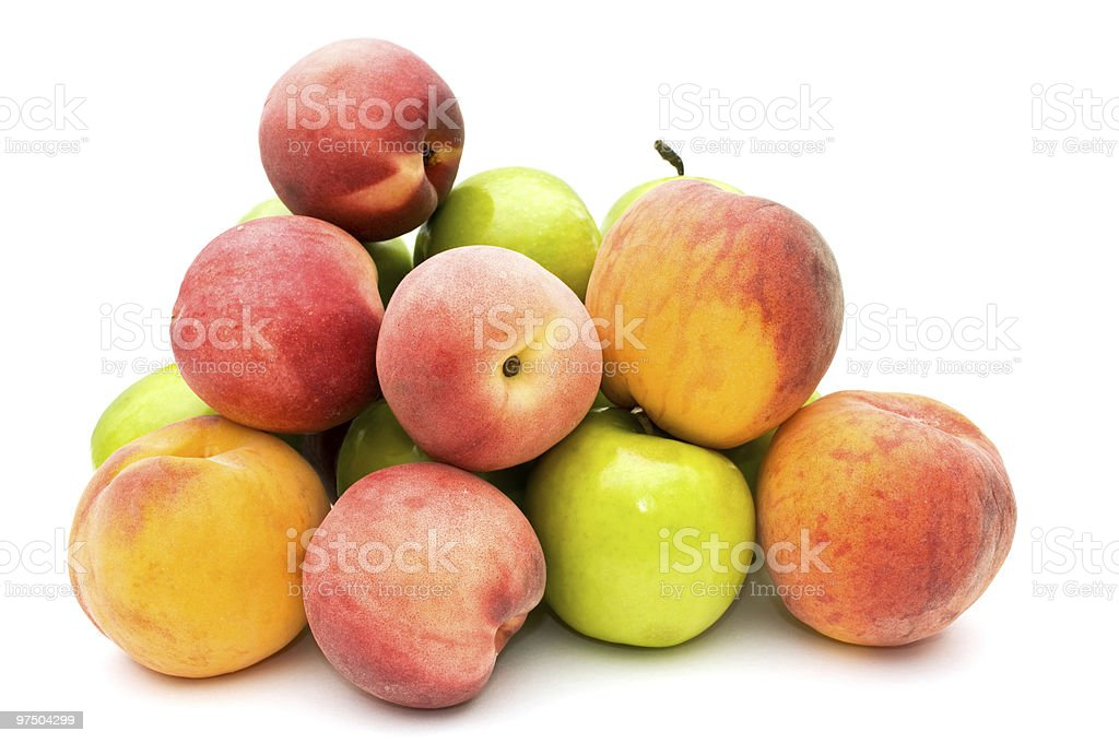 Green apples and peaches. royalty-free stock photo