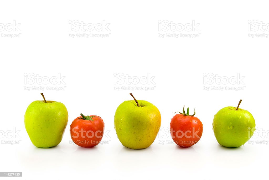 green apples and red tomatoes royalty-free stock photo