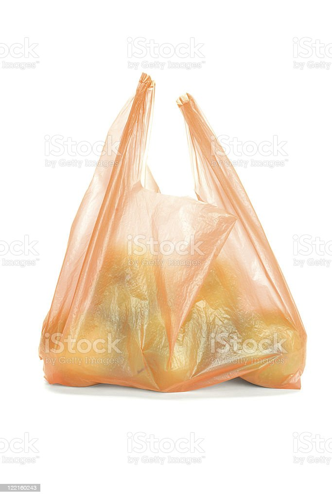 Green apples in plastic bag royalty-free stock photo