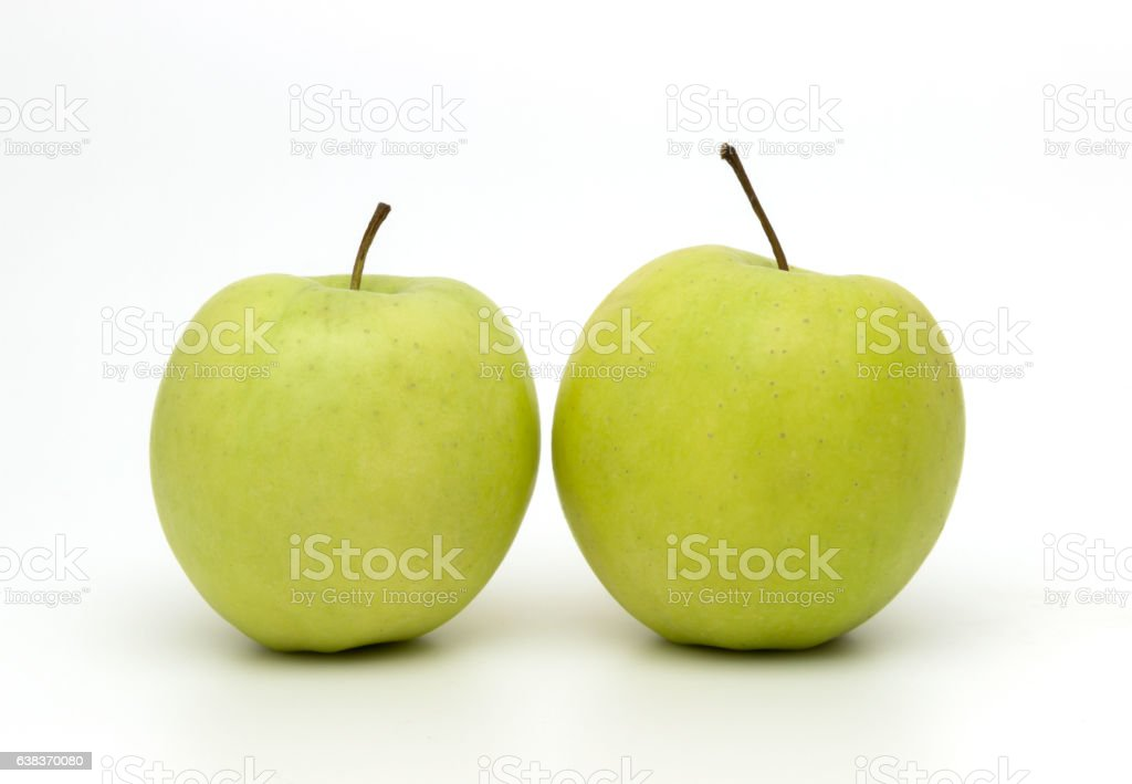 Green apples on a white background stock photo