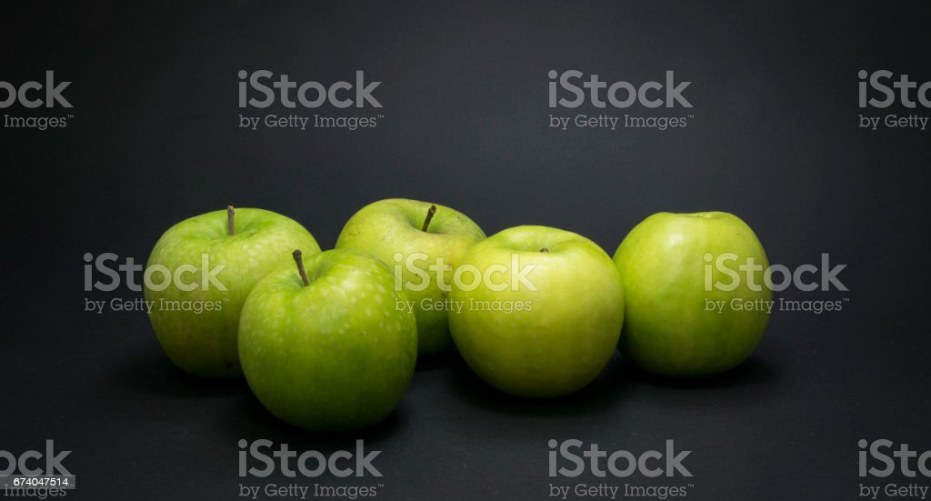 Green apples on black background. royalty-free stock photo