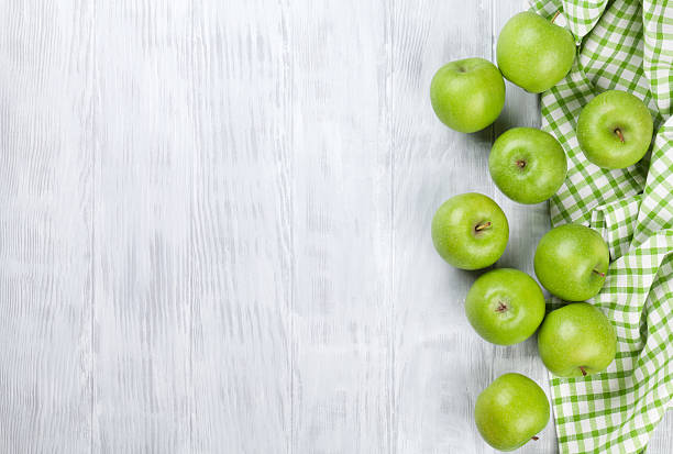 Green apples Green apples over wooden table. Top view with copy space granny smith apple stock pictures, royalty-free photos & images