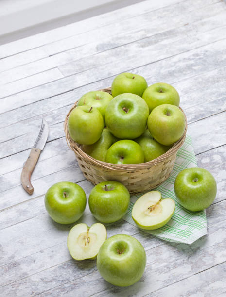 Green Apples Large group of green apples, Studio shot granny smith apple stock pictures, royalty-free photos & images
