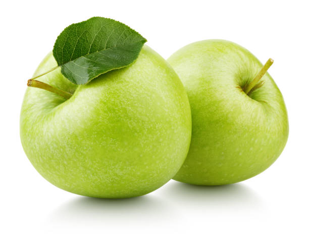 Green apples with leaf isolated on white Two ripe green apple fruits with apple leaf isolated on white background. Green apples with clipping path granny smith apple stock pictures, royalty-free photos & images