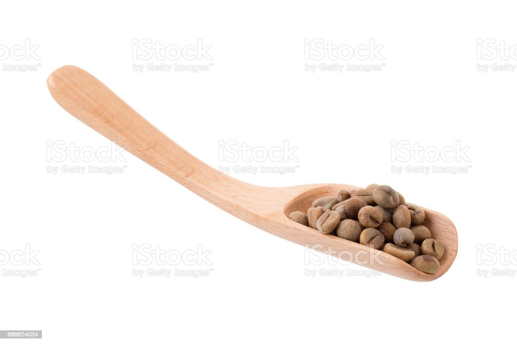 Green Arabica coffee beans in a wooden spoon Isolated on a white background royalty-free stock photo