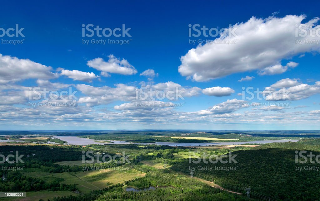 Green Arkansas landscape under a blue cloudy sky stock photo