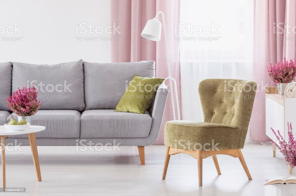 Green Armchair Standing In White Living Room Interior With Grey