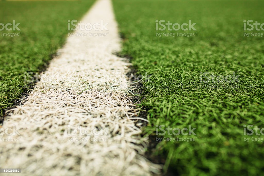 Green artificial grass soccer field. The white line on a Green football field background. stock photo