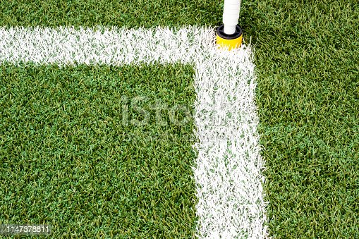 istock Green artificial grass with white lines. 1147378811