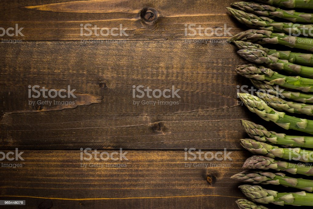 Green Asparagus on Wooden Background with Copy Space zbiór zdjęć royalty-free