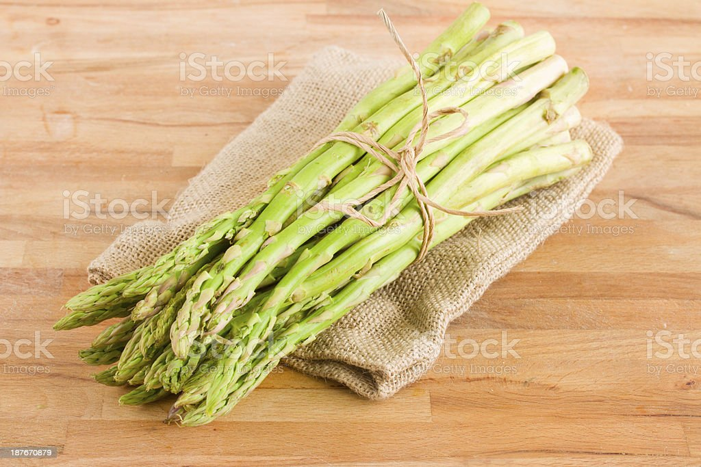 green asparagus sprouts on table royalty-free stock photo