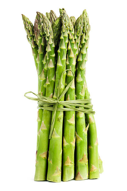 green asparagus vegetable bundle, fresh food isolated on white background - asparagus stock pictures, royalty-free photos & images